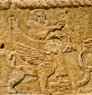 from phoenician era: the rotten plant in the kings hand and his feet put behind each other means that the king is shown as already deceased.