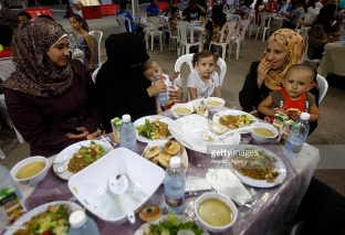 BEIRUT, LEBANON - JUNE 29: Muslims gather in iftar tents to break their fast on the first day of holy month Ramadan in Beirut, Lebanon on June 29,2014. Islam's holy month of Ramadan is celebrated by Muslims all over the world marked by fasting, abstaining from food, beverage and smoking from dawn to dusk. (Photo by Bilal Jawich/Anadolu Agency/Getty Images)