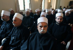 Druze clerics taking part in a meeting of the sect's religious leadership in Beirut, Lebanon, Friday, June 12, 2015. Lebanon's political leader of the Druze community says this week's attack in northwestern Syria by al-Qaida's branch that many members of the sect dead was an individual incident. (AP Photo/Bilal Hussein)