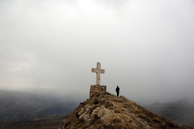 TOPSHOT - A Lebanese trecker takes a pic